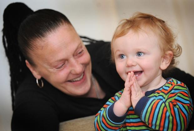 Toddler Archie Lumley is all smiles now with his grandmother Alison Barry as he recovers at home from his pneumonia ordeal at Christmas