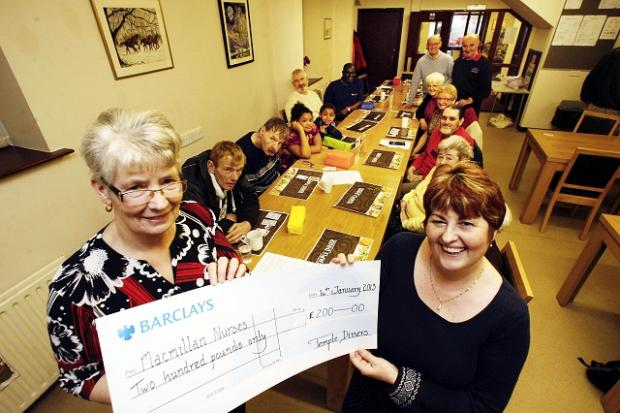 Temple Diners secretary Margaret Thomas (left) hands the cheque to Claire Parkinson, Macmillan gynaecology nurse specialist at Airedale Hospital
