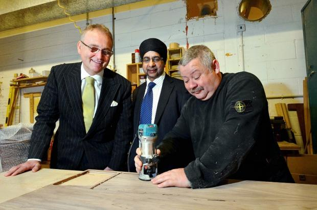 VISIT: Balbir Panesar (centre), chairman of PEC Building Services, with the visiting John Longworth (left) and factory worker Mark Johnson