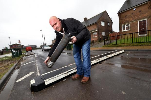 Richard Rushworth with the vandalised temporary roadblock and bollards in Holme Wood