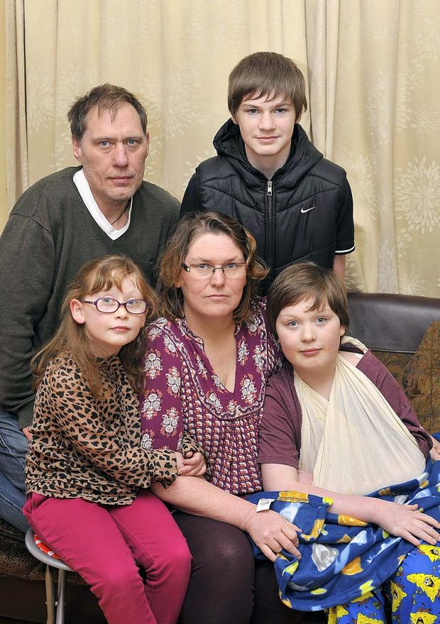 Bradford Telegraph and Argus: Andrew and Jacqueline Hill with children Cameron, Lornarose and injured Kieran