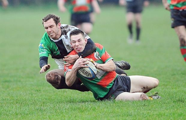 MATT FINISH: Wibsey's Matt Holdsworth touches down despite a tackle from Rodillians' Scott Cranmer