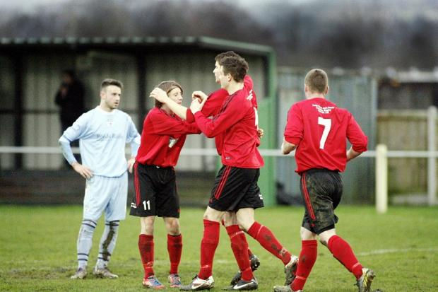 Silsden players celebrate after Danny Husband netted a first-half equaliser