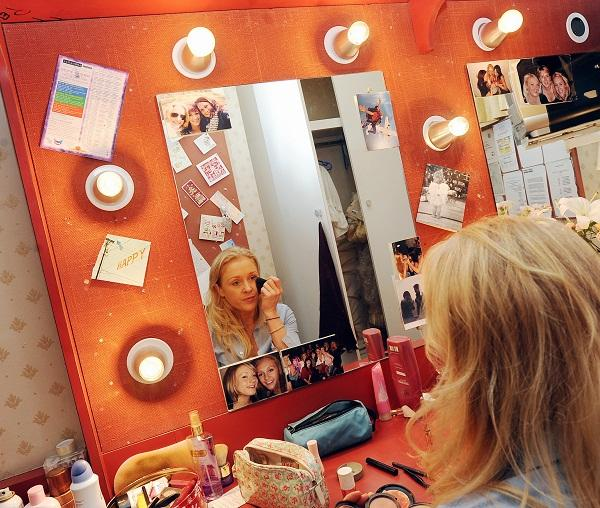 Hannah Grover, who plays Cinderella, puts on her make up before the curtain goes up on the Alhambra pantomime