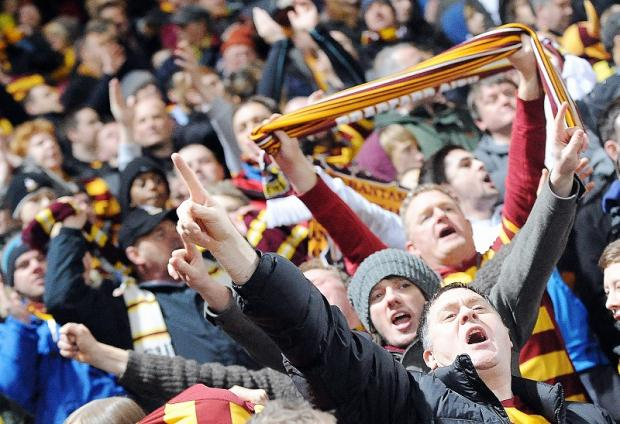 Bradford City supporters roar their side on to victory against Aston Villa in the semi-final first-leg