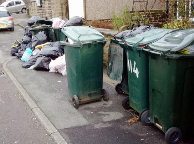 The photograph of uncollected bins in Sandy Lane, Crossflats
