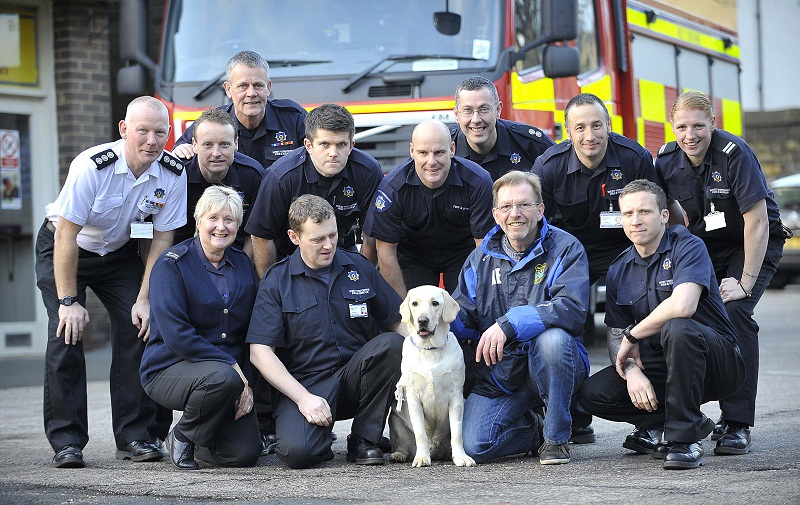 Zak is pictured with members of the Cleckheaton fire service
