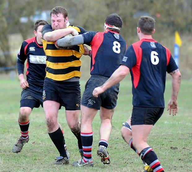 Old Grovians' Tom Dalton runs the ball at Ossett No 8 Dan Wray