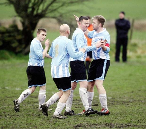 Silsden Whitestar celebrate their equaliser in the first half of their West Riding County FA Challenge Trophy defeat against Oxenhope Recreation Reserves