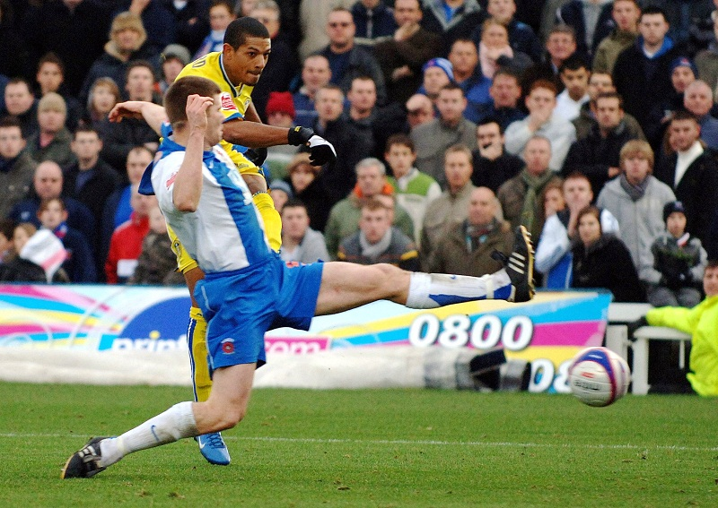 Michael Nelson tackles Leeds' Jermaine Beckford during Hartlepool's League One clash with the Whites in 2007