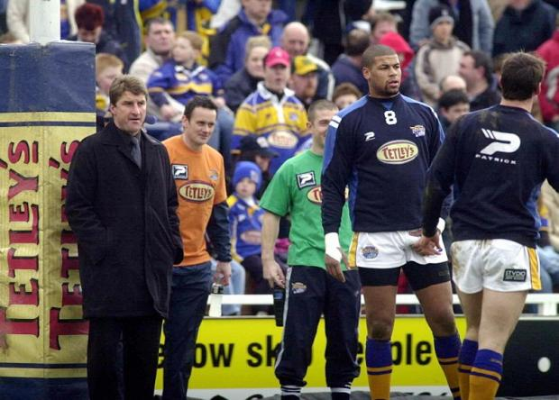 Francis Cummins looks on as Tony Smith supervises a Leeds warm-up session before a match