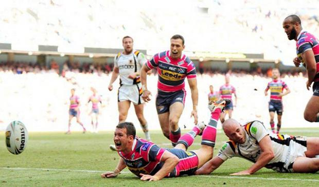 Bradford Telegraph and Argus: Danny McGuire, seen scoring a try against the Bulls during Magic Weekend last year, is remarkable because he has been in the firing line for ten years says Rhinos' head coach Brian McDermott