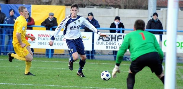 Guiseley's Josh Wilson in action against Oxford City - the Lions' sixth straight league win