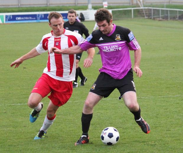 Avenue's Paul Walker in action at Brackley Town last Saturday but the Horsfall club will do well to play this weekend, given the forecast. Picture: John Rhodes