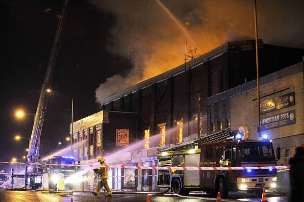 Fire crews tackle the blaze at the height of last night's drama