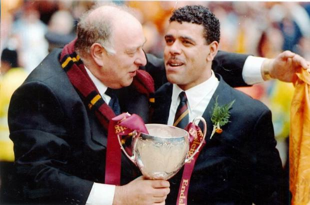 Chris Kamara receives congratulations from City chairman Geoffrey Richmond after winning at Wembley