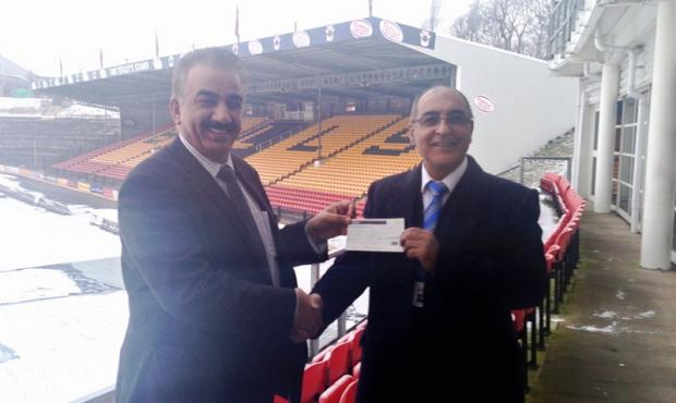 Omar Khan receives the cheque from Akbar's