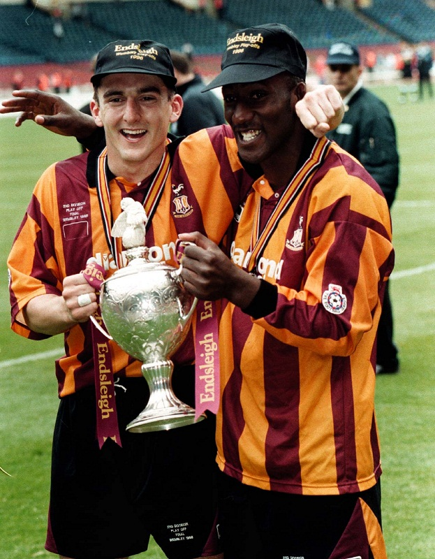 Goalscorers Mark Stallard and Des Hamilton show off the Second Division play-off final trophy after victory over Notts County at Wembley in 1996