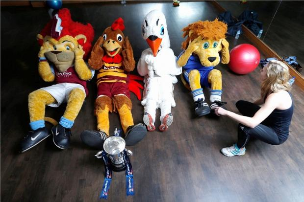 The mascots are put through their paces by personal trainer Charlotte Ord
