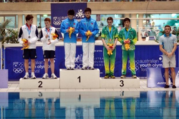 Sam Thornton, second left, celebrates his silver medal in the three-metre synchro with Freddie Woodward