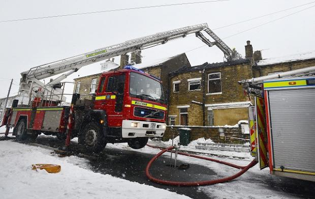 Firefighters at the scene of the fire in Heaton