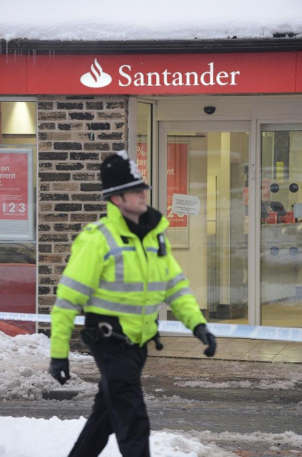Police outside the Santander branch in Wibsey attacked by the armed gang