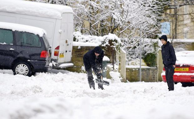 Commuters start to dig out their vehicles in the deep snow