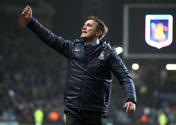 Phil Parkinson celebrates at Villa Park after City reached the Capital One Cup final