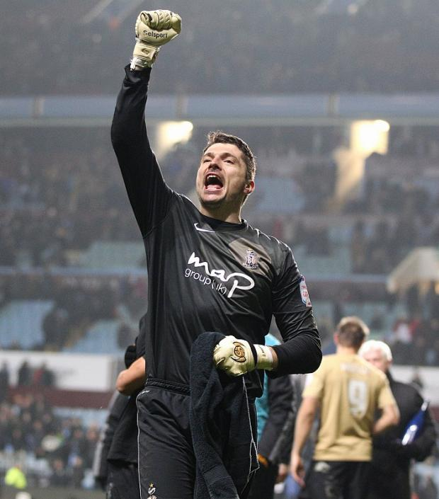 Matt Duke celebrates after City reached the Capital One Cup final