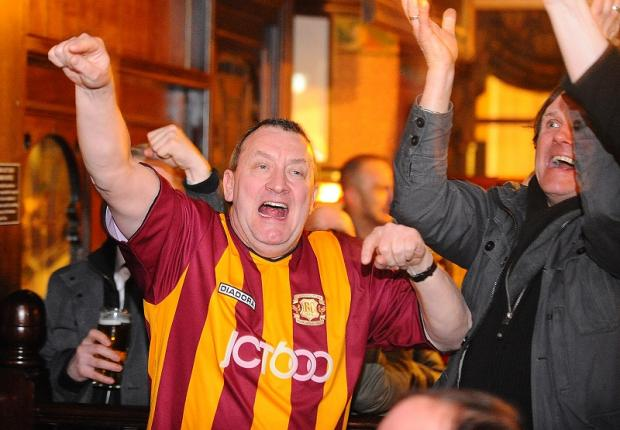 Ecstatic City fans celebrate in City Vaults pub in the city centre as James Hanson scores the Bantams' equaliser