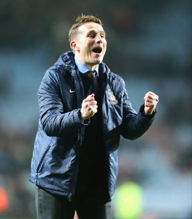 Phil Parkinson, seen celebrating the win over Aston Villa, has been hailed as 'amazing' by captain Gary Jones