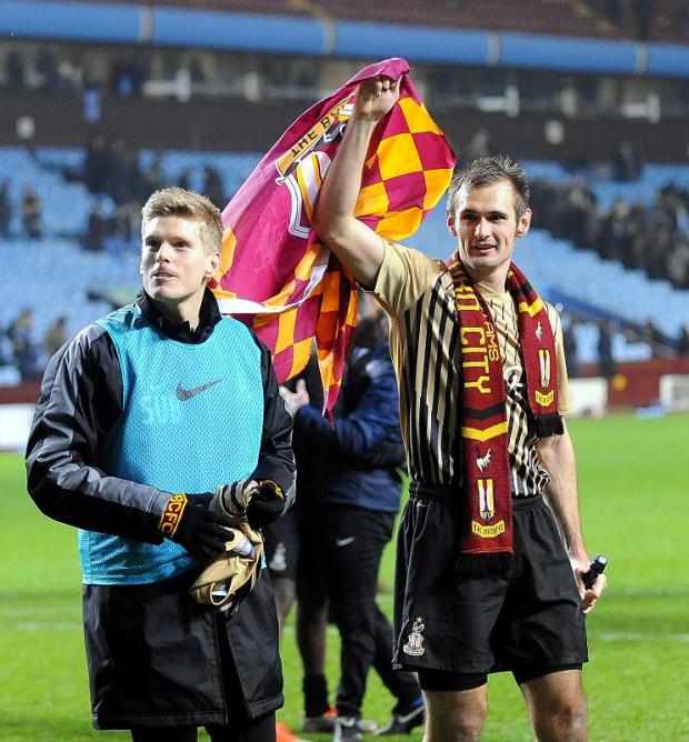 Bradford City's goal hero James Hanson celebrates victory at Villa Park with substitute Alan Connell