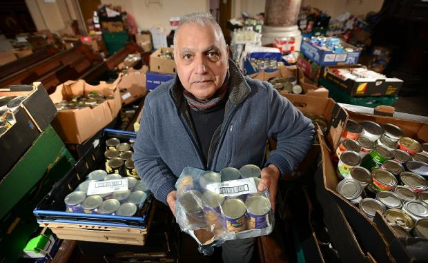 Lashman Singh in the storage area at Bradford Metropolitan Foodbank in Barkerend