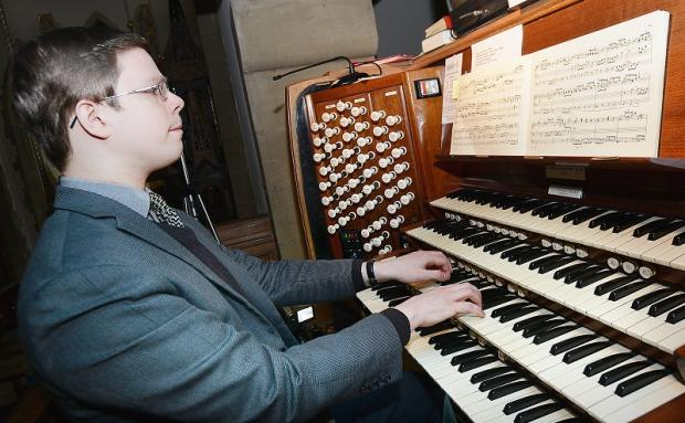 Alex Woodrow at the organ