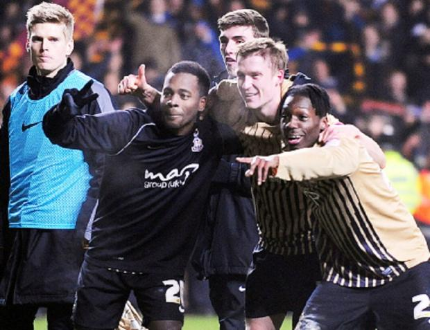 SEE YOU AT WEMBLEY: Zavon Hines, Stephen Darby and Blair Turgott celebrate victory over Aston Villa