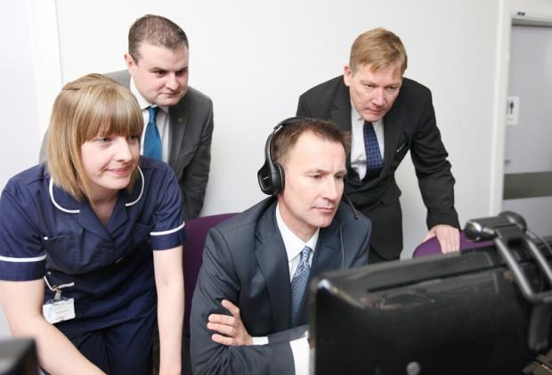 Health Minister Jeremy Hunt and health  sister Sadia Salt use the telemedicine video link with MPs Andrew Stephenson (Con, Pendle) and Kris Hopkins looking on
