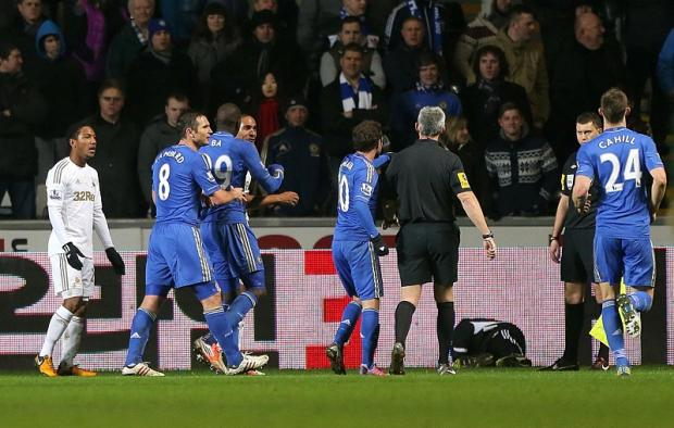 Chelsea players react during the infamous ballboy incident as they bowed out of the Capital One Cup to Swansea