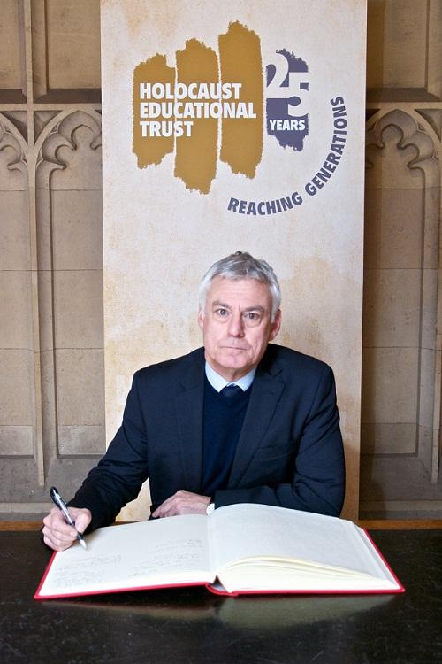 David Ward signing the Holocaust Memorial Day Book of Commitment