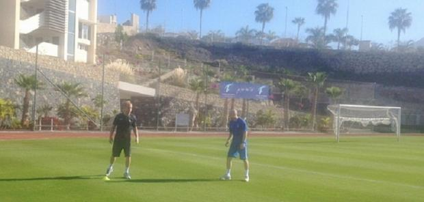 Recovering defender Andrew Davies trains with fitness coach Nick Allamby in Tenerife