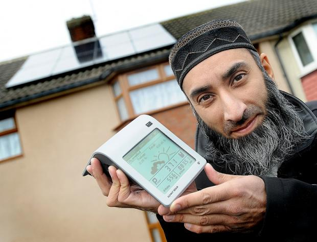 Yasser Taj outside his home in Newill Close which also boasts solar panels to produce electricity