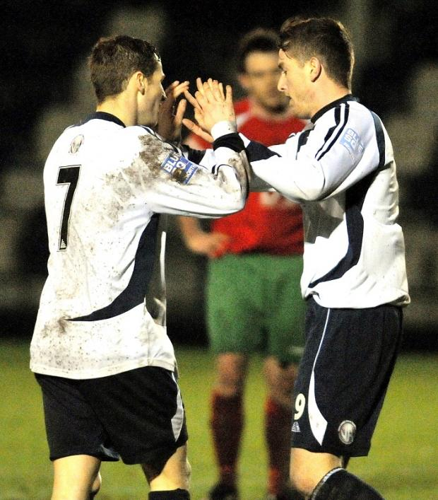 Bradford Telegraph and Argus: HIGH FIVE: Guiseley scorer Wayne Brooksby, left, is congratulated by Josh Wilson at Nethermoor tonight