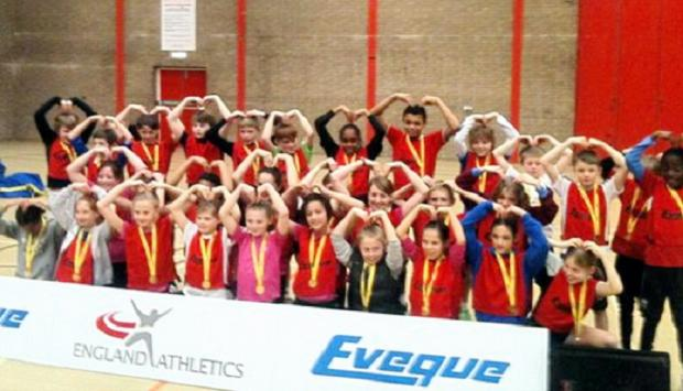 West Yorkshire's boys' and girls' teams celebrate their sportshall athletics successes with a Mobot