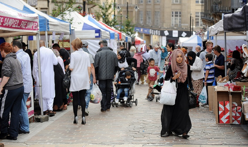 A snapshot of Bradford's population – shoppers at last year's continental market in the city centre