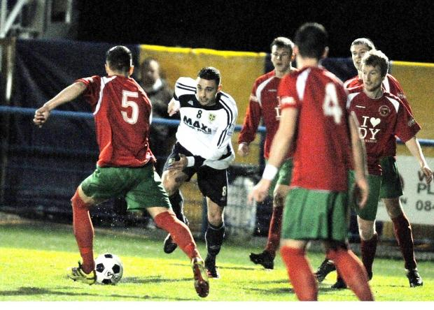 Guiseley's Matt Wilson in action during Tuesday night's comprehensive 5-0 victory over Harrogate Railway Athletic in the semi-final of the West Riding County Cup
