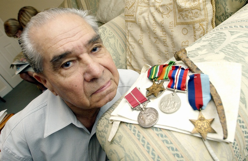 Alfred Peterson with his medals