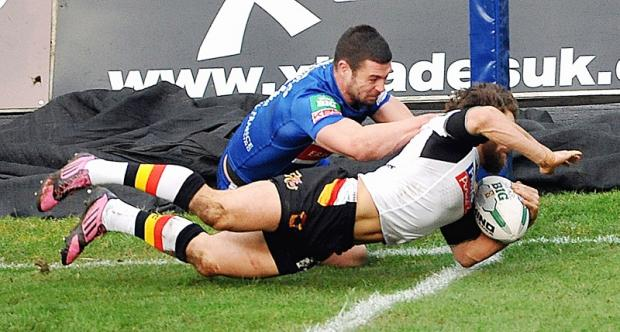 Bradford Telegraph and Argus: Jarrod Sammut dives across the line for the first of his two tries