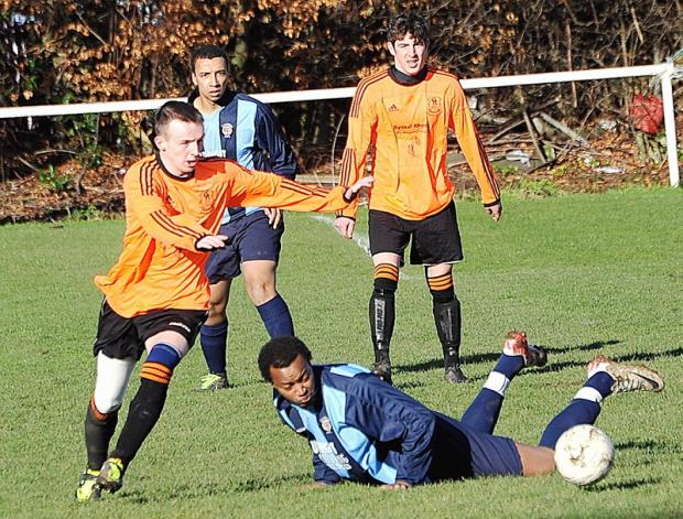 Michael Donahue, of Oxenhope Recreation Reserves, skips past Campion Reserves' Barry Mamadou during their West Riding County FA Trophy tie
