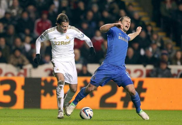 Branislav Ivanovic of Chelsea and Swansea striker Michu clash during their Capital One Cup semi-final