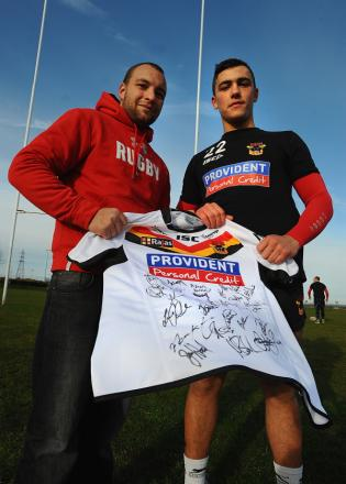 Lance Corporal Jamie Sykes receives a signed shirt from Jobe Murphy at the Bradford Bulls' training ground