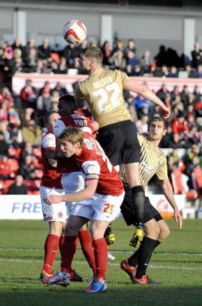 Michael Nelson wins an aerial duel in the draw at Fleetwood